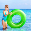 Child holding inflatable ring.. - Foto de Stock