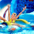 Child on water slide at aquapark. — Stock Photo #7610889