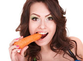 Face of girl eating carrot. — Stock Photo