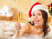 Woman in santa hat relax in bath. — Stock Photo