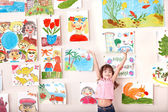 Child in art class with picture. — Foto Stock