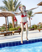 Child jumping in swimming pool. — Stock Photo