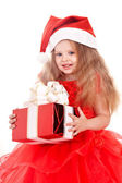 Child in red santa hat holding gift box. — Stock Photo