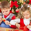 Stock Photo: Kids making decoration for Christmas.