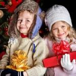 Kid with Christmas gift box. — Stock Photo #7840932