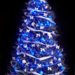 Christmas tree with light and blue star. — Стоковая фотография
