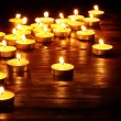 Group of  candles on  black background. — Stock Photo