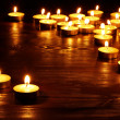 Stock Photo: Group of candles on black background.