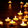 Group of candles on black background. — Zdjęcie stockowe #7841059