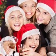 Royalty-Free Stock Photo: Group young in santa hat at nightclub.