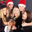 Group in santa and witch hat . — Stockfoto
