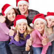 Group young in santa hat show thumbs up. — Stock Photo #7843139