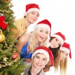 Group young by christmas tree. — Stock Photo #7843178