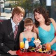 Family with child in restaurant. — Stock Photo