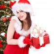 Christmas girl in santa holding gift box. - Foto Stock