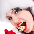 Christmas girl in red santa hat and cake on plate. — Stock Photo #7843797