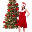 Christmas girl in santa hat holding stack gift box. — Stock Photo #7843802