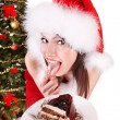 Christmas girl in santa hat eat cake . — Foto Stock