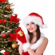 Girl in santa hat holding  christmas ball. — Stock Photo #7843825