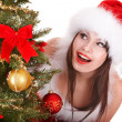 Christmas girl in santa hat holding stack  gift box. — Foto de Stock