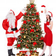 Santa claus and girl by christmas tree . — Stock Photo #7844617