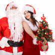 Santa clause and christmas girl with tree. — Foto Stock