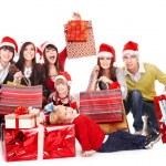 Happy group in santa hat . — Stock Photo #7845334
