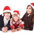 Happy family with child in santa hat. — Foto Stock