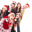 Happy group in santa hat . — Stock Photo