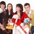 Happy men and girl with group gift box. — Stock Photo