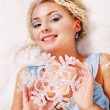 Young woman holding snowflake. — Stock Photo