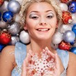 Young woman in christmas balls. — Stock Photo #7846511