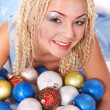 Young woman in christmas balls. — Stock Photo #7846524