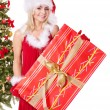 Christmas girl in santa hat holding gift box. — Stock Photo