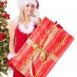 Christmas girl in santa hat holding gift box. — Stock Photo
