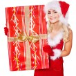 Girl in santa hat holding gift box . — Stock Photo #7846533