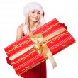 Girl in santa hat holding gift box . — Stock Photo #7846535