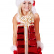 Christmas girl in santa hat holding stack gift box. — Stock Photo #7846540
