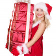 Christmas girl in santa hat holding red gift box. — Stock Photo #7846542