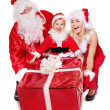 Santa claus family with child. — Stock Photo