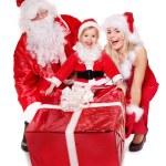 Santa claus family with child. — Stock Photo