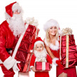 Santa claus family with child holding gift box.. — Stock Photo