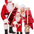 Santa claus family with child holding stack gift box.. — Stock Photo #7846584
