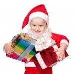 Child in santa costume holding group gift box. — Stock Photo