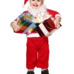 Child in santa costume holding gift box. — Stock Photo