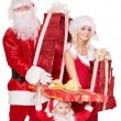 Stock Photo: Santa claus family with child holding stack gift box..