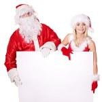 Santa claus and christmas girl holding banner. — Stock Photo