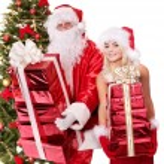 Santa claus and girl giving gift box. — Stock Photo