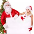 Stock Photo: Santa claus and christmas girl holding banner.