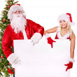 Santa claus and christmas girl holding banner. — Stock Photo #7846623
